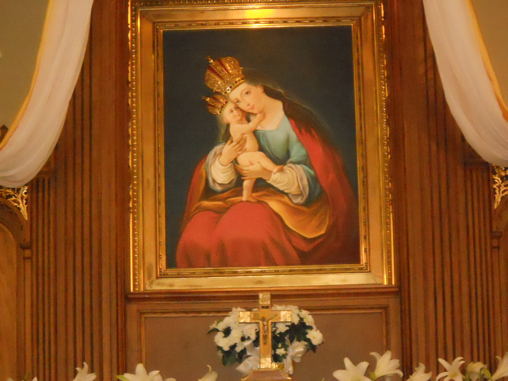 blessed mother mary over alter