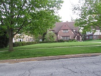 beautiful tudor style home and yard